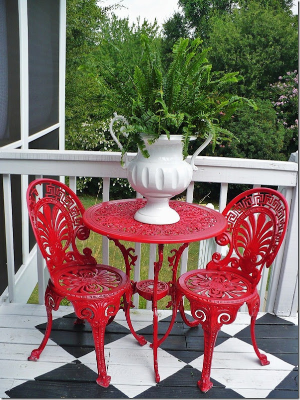 red bistro set on checkerboard floor