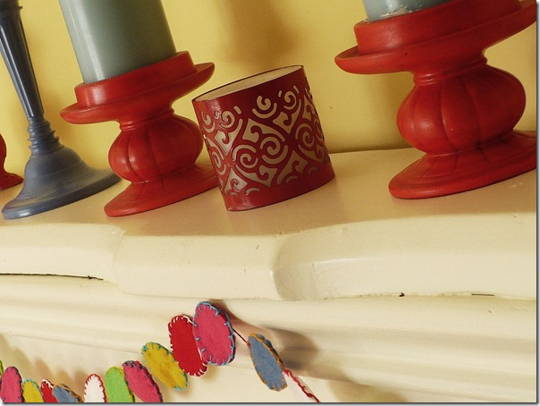 colorful-candlesticks-candles-on a fireplace mantle