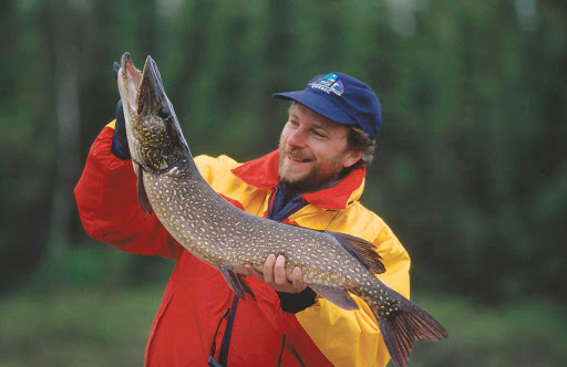 pike-fishing-Quebec - A fisherman shows off the pike he caught in Abitibi-Temiscamingue, Quebec, Canada.