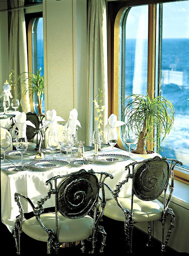 Holland-America-Vista-Class-Pinnacle-Grill - Head to the Pinnacle Grill during your Zuiderdam cruise for fine dining in a refined atmosphere — and a sumptuous view.