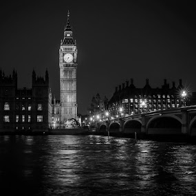 Reflections on the Thames by Jan Murphy - Black & White Buildings & Architecture ( water, clock, black and white, windows, lamps, lights, london, thames, glisten, westminster bridge, night, big ben, houses of parliament, lamp posts, , city at night, street at night, park at night, nightlife, night life, nighttime in the city )