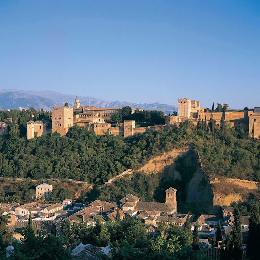A scenic view of Alhambra, the historic royal palace and fortress — originally constructed in 889 and rebuilt in the mid-11th century — in the city of Granada in the Andalusia region of southern Spain.