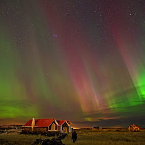 Something is in the sky by Bragi Kort - Landscapes Cloud Formations ( iceland, red northern lights, stars, aurora borealis, northern lights, red aurora, long exposure, old shed, lights in the sky )