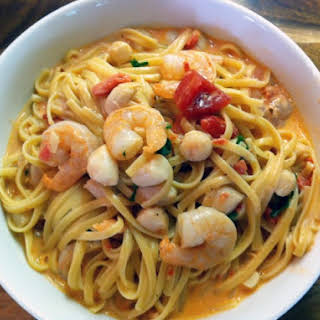 Linguini With Shrimp And Bay Scallops In A Creamy Tomato Vodka Sauce.
