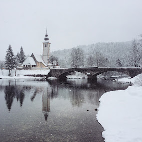 Church on the Bridge in the winter by Aleš Krivec - Landscapes Travel ( clouds, hills, hill, reflection, white, snowy, lake, forest, frozen, leaves, woods, mystic, winter, nature, heavy snow, fog, snow, sunrays, trees )