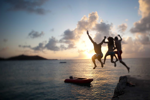 sunset-rock-leap-St-Maarten - As the sun sets on St. Maarten, visitors take one last leap into the sea.