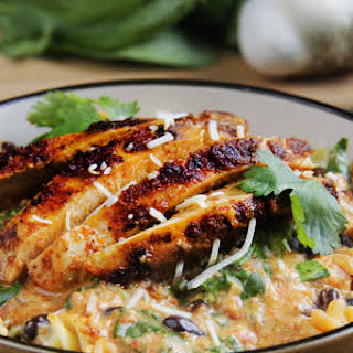 TexMex Creamy Roasted Red Pepper Pasta with Blackened Chipotle Chicken, Black Beans & Spinach.