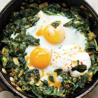 Skillet-Baked Eggs with Spinach, Yogurt, and Chili Oil.
