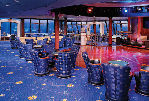 Enjoy the great ocean views when you stop by Norwegian Spirit's Galaxy of the Stars Observation Lounge for drinks and appetizers.
