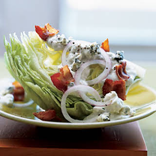 Iceberg Wedge with Warm Bacon and Blue Cheese Dressing.