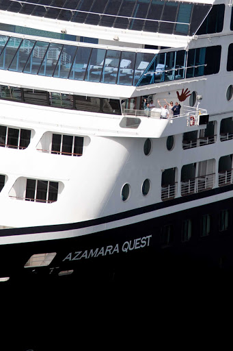 Azamara-Quest-closeup - Some friendly guests wave from the bow of Amamara Quest.
