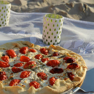 Savory Tart with Fresh goat cheese, Tomato, and Thyme and Olive Oil Crust..