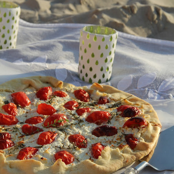 Savory Tart with Fresh Goat Cheese, Tomato, and Thyme and Olive Oil Crust. Recipe