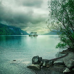 Lake of Brienz by Christian Diboky - Landscapes Waterscapes ( water, platform, blue, green, brienzersee, brienz, dramatic, cloudy, switzerland, grey, lake, stones,  )