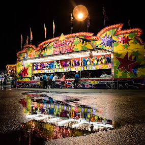 Rainy Night on the Midway by Russell McFarland - City,  Street & Park  Amusement Parks ( rainy night, rainy, carnival, columbia, sc state fair, columbia sc, festival, carnival games, state fair, midway )
