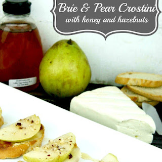 Brie & Pear Crostini with Honey and Hazelnuts.