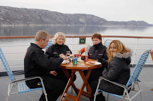 Hurtigruten-dining-in-Greenland - Dine al fresco as never before — surrounded by grand views of Greenland's mountain range and icy waters — aboard a Hurtigruten sailing.