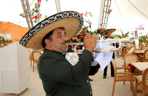 mariachi-brass-Cozumel - Mariachi serenade visitors to Playa Mia on the island of Cozumel.