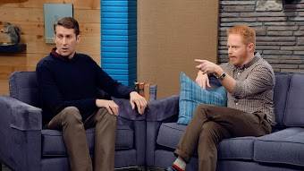 Jesse Tyler Ferguson Wears a Brown Checked Shirt and Stripey Socks