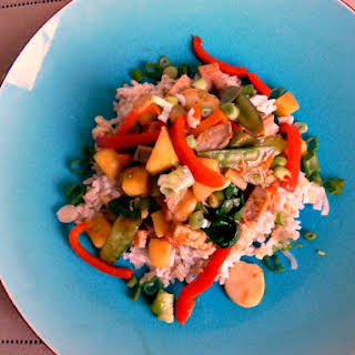 Pork Tenderloin Stir Fry With Mango, Red Bell Pepper, and Baby Spinach.
