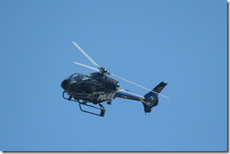 Police helicopter watches from the sky