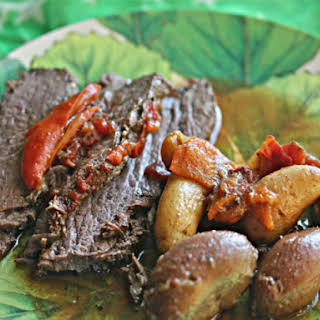 Tangy Slow-Cooker Brisket With Potatoes and Sweet Peppers.