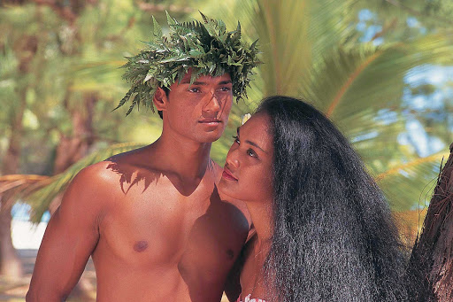 Tahiti-couple - A Tahitian couple in traditional dress are about to greet visitors to their island.