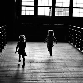Run by Suzanne Tutak - Babies & Children Children Candids ( b&w, black and white, silhouette, children, windows, kids, sunlight, running, shadows, shadow and light, playing, high contrast, light, vertical lines, pwc )