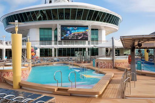 Navigator-of-the-Seas-movie-screen-pool - Watch a flick on Navigator of the Seas' giant outdoor movie screen while taking a dip in the pool or relaxing on the deck.