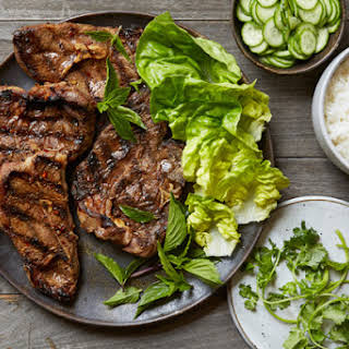 Grilled Sichuan Cumin Lamb Chops with Quick Pickled Cucumbers.