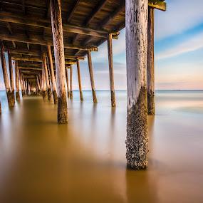 Norfolk Pier by Givanni Mikel - Buildings & Architecture Bridges & Suspended Structures ( sand, hdr, norfolk, pier, ocean, beach, landscape, landscapes, pillars,  )