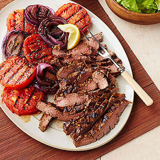 Molasses-Mustard Marinated Flank Steak with Grilled Tomatoes and Onions.