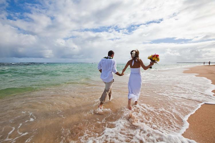 Hawaii is for lovers: Walking along the beach in Kauai.