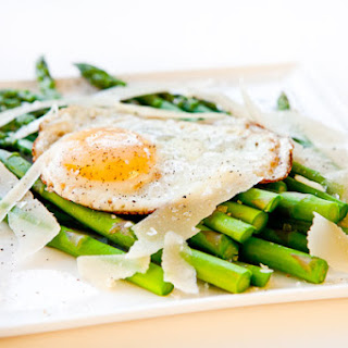 Asparagus with Fried Egg and Parmesan Cheese.