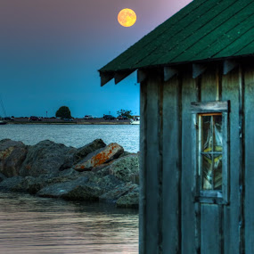 Harvest Moon Fish House by David Johnson - Buildings & Architecture Public & Historical ( reflection, moon, harbor, lake superior, house )