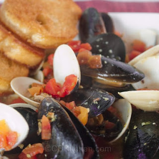 Little Neck Clams And Mussels In A Spicy Broth