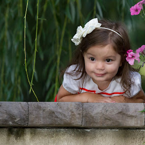 Looking Over by Craig Lybbert - Babies & Children Child Portraits ( child, girl, happy, smile, flowers, red dress,  )