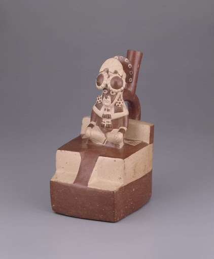 Sculptural ceramic ceremonial vessel that represents a priest sitting on a stepped pyramid with ramp ML010855