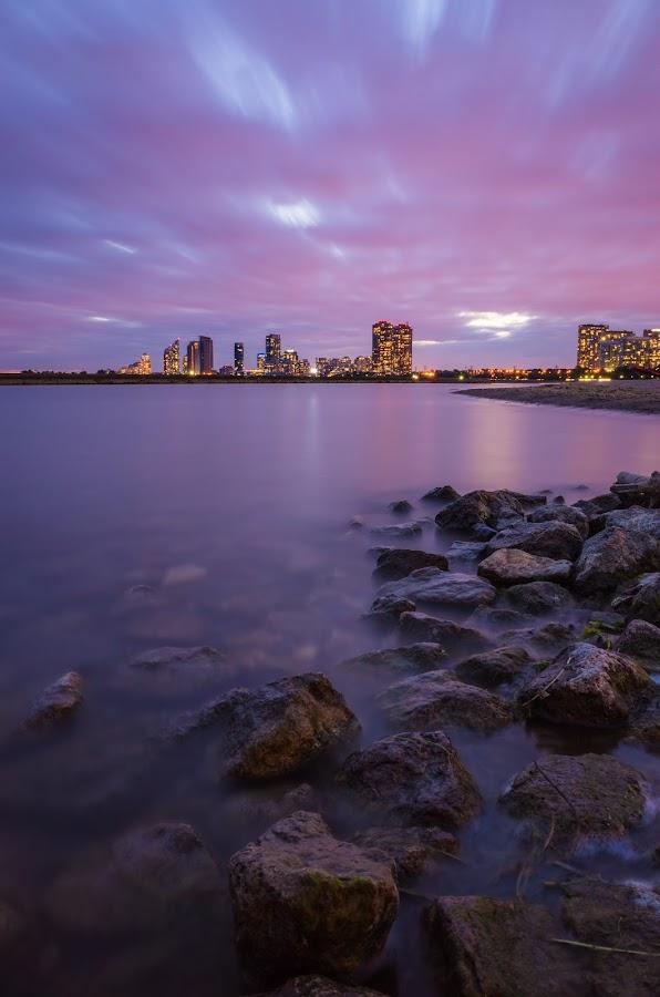 Beach Sunset by Steve McCaffrey - Landscapes Beaches ( lake ontario, clouds, water, skyline, sky, toronto, sunset, long exposure, beach, rocks )