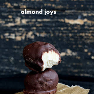 Almond Joys with Crunchy Coconut Center Enrobed in Raw Chocolate.