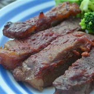 Baked Round Steak in Barbeque Sauce.