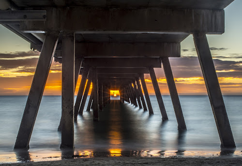 That One in a Million Shot by Sharon Wills - Buildings & Architecture Bridges & Suspended Structures ( south australia, sun set, australian, glare, sea, ocean, jetty, orange sky, sun, colour, sunburst, colourful, glenelg, sun burst, sunset, peir, australia, south australian,  )