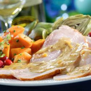Ham with Maille® Orange Sauce.