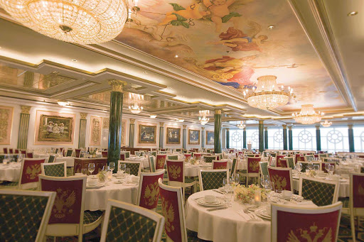 Norwegian-Pearl-Dining-Palace - Russian-inspired furniture, beautiful ceiling paintings and five-course meals welcome guests at the Summer Palace restaurant board Norwegian Pearl.