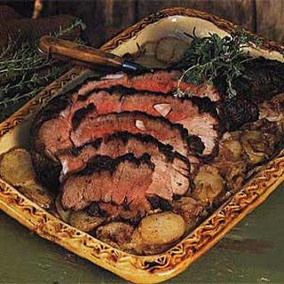 Roast Leg of Lamb with Potatoes and Onions.