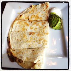 In-edible GF cheese quesadilla with half browned guacamole :(