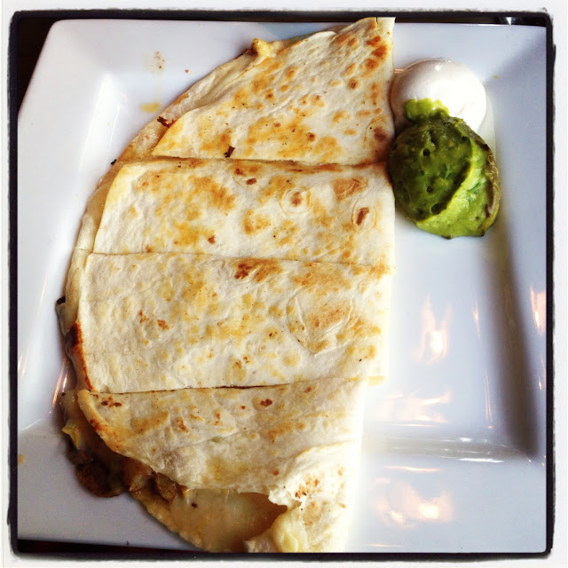 In-edible GF cheese quesadilla with half browned guacamole :(