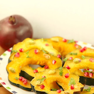Healthy Roasted Acorn Squash with Pomegranate and Pistachios