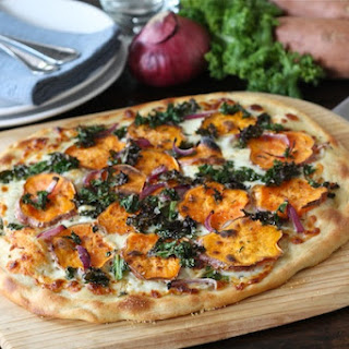 Sweet Potato Kale Pizza with Rosemary & Red Onion.