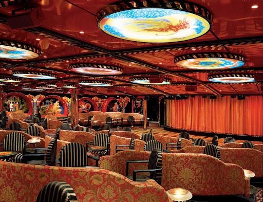 Carnival-Legend-Firebird-Lounge - You can catch feature films and late-night comedy acts at the Firebird Lounge on deck 1 of Carnival Legend.